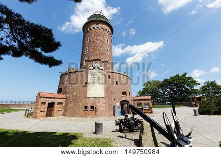 KOLOBRZEG POLAND - JUNE 22 2016: Massive building of the lighthouse with its 26 meters high is one of the most recognizable tourist attractions in the city