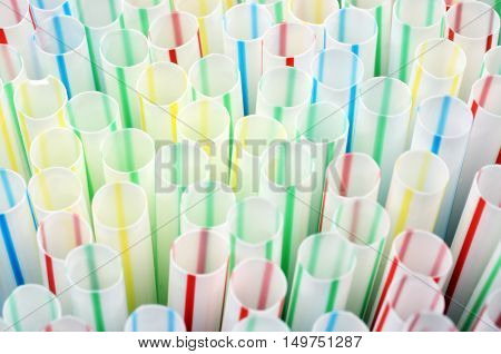 Close up of pack of Colored plastic straws