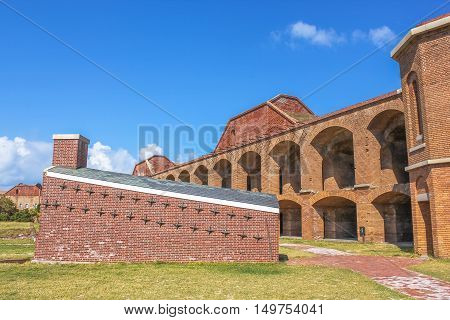 Inner wall, houses and courtyard in Fort Jefferson at Dry Tortugas National Park, Florida. Old sections of Fort Jefferson lie in ruins within the fort's massive courtyard.
