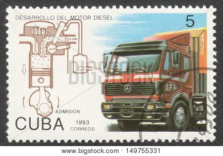 MOSCOW RUSSIA - CIRCA SEPTEMBER 2016: a stamp printed in CUBA shows a truck and diesel engine circuit the series