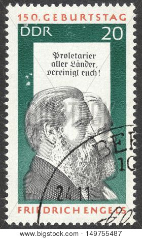MOSCOW RUSSIA - CIRCA SEPTEMBER 2016: a stamp printed in DDR shows portraits of Friedrich Engels and Karl Marx the series