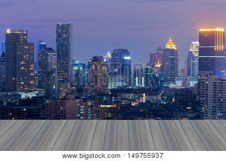Opening wooden floor, City lights night view, cityscape downtown at twilight