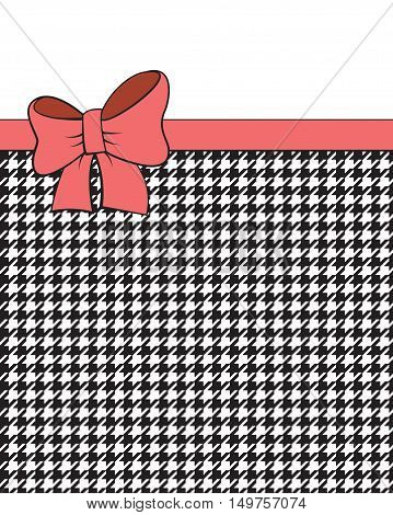 Pink ribbon on black and white geometric background, houndstooth pattern.