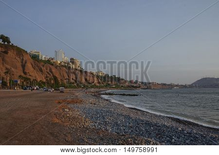 View Of Lima Coastline And City Beach At Sunset In Miraflores District, Lima, Peru