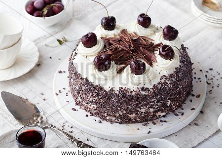 Black forest cake, Schwarzwald pie, dark chocolate and cherry dessert on a white wooden background