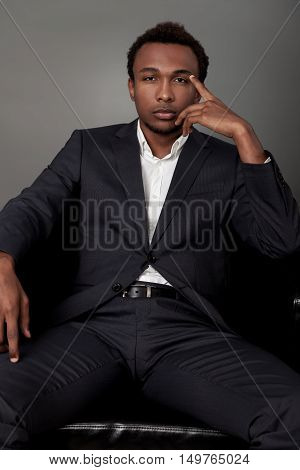 Serious Businessman In Leather Armchair