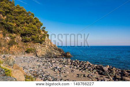 The Ligurian Coast between Varazze and Cogoletothe stones beach typical of Ligurian coast.