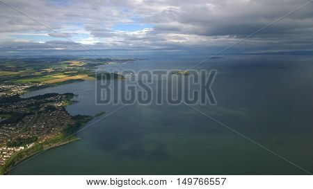 An aerial view over the firth of forth and Dalgety bay, out towards Inchcolm island