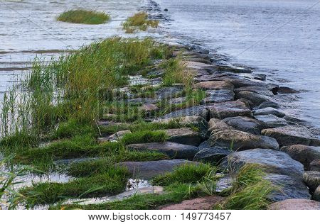 Natural Stony Breakwater On A Lake