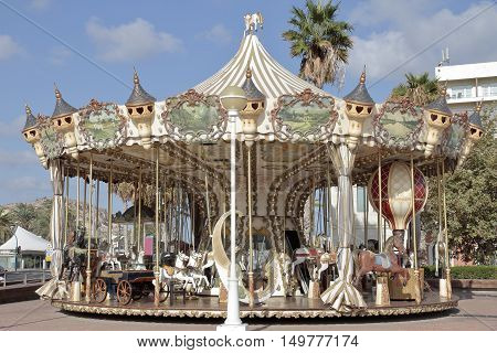 colorfull carousel installed on the street in the city of alicante spain