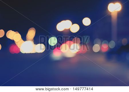 Night lights of the City. Defocused carlights in the night street.