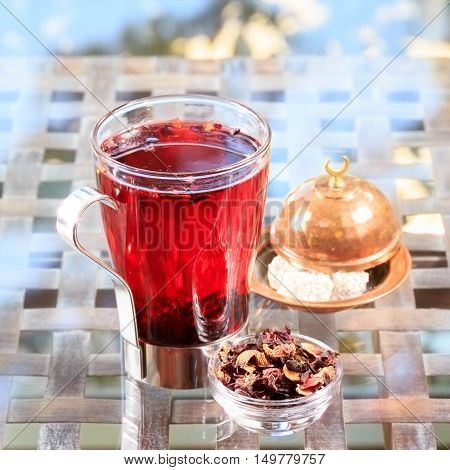 Concept Of Herbal Tea. Hibiscus Tea In A Glass Mug With Turkish Locum. Healthy Caffein-free Drink.