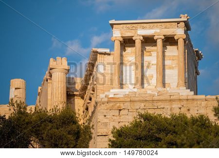 Small but gut preserved Temple of Athena meets the tourists at the very entrance to the Acropolis of Athens.