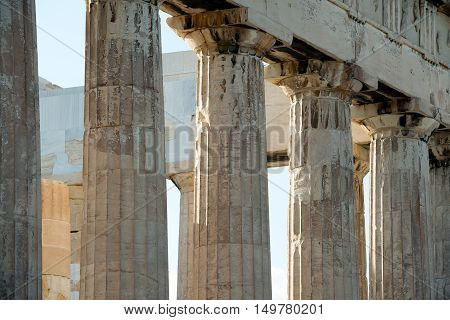 Old walls and columns of the ruined Parthenon Acropolis of Athens convey the grandeur of the ancient building