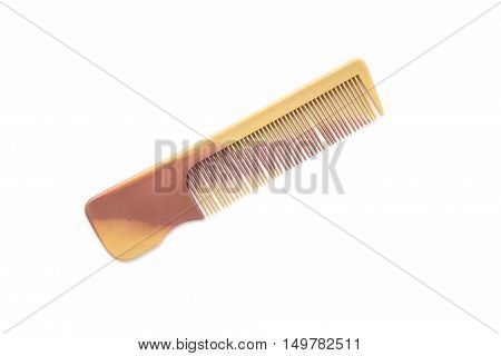 It is Brown plastic comb isolated on white