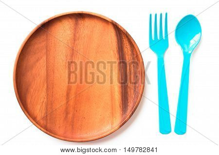 empty wood plate and spoon on white background / can be used display your product / Top view.