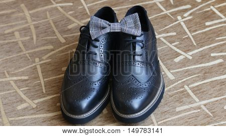 groom  traditional wedding shoes and bow tie