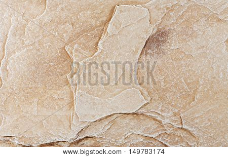 texture of yellow stone with stains biege