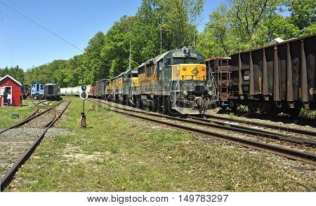 Lenox, USA - May 22, 2014: Old locomotive makes its way on the Berkshire Scenic Railroad.