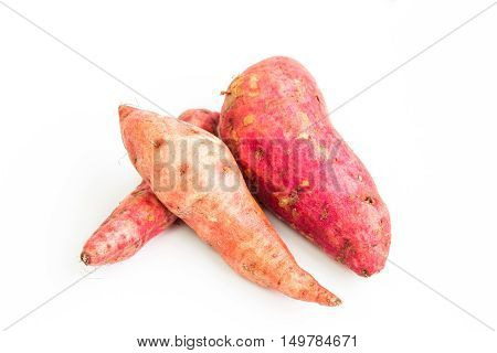 Sweet potato over a white background / Fresh purple yams isolated on a white background
