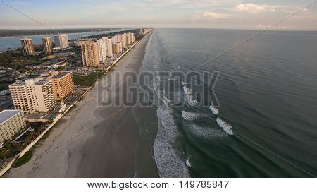 Aerial view of sunrise in Florida and waves on the beach