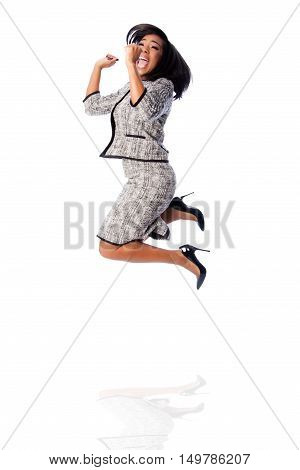 Winning Business Woman Jumping Cheering
