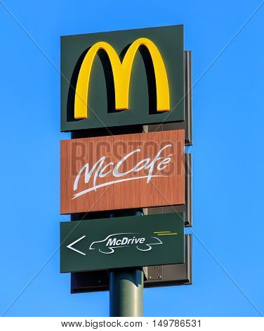 Rumlang Switzerland - 30 September 2016: McDonald's signs against blue sky. McDonald's is the world's largest chain of hamburger fast food restaurants founded in the United States in 1940.