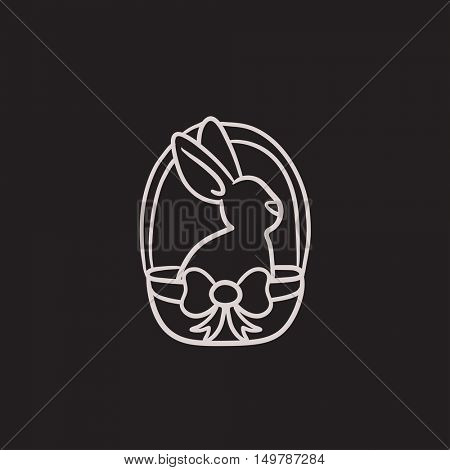 Easter bunny sitting in basket vector sketch icon isolated on background. Hand drawn Easter bunny sitting in basket icon. Easter bunny sitting in basket sketch icon for infographic, website or app.