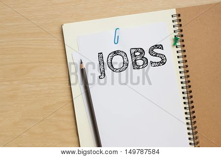 jobs text message on white paper note on the desk / business concept
