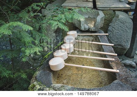 Close up of ladle on bamboo in japanese shrine