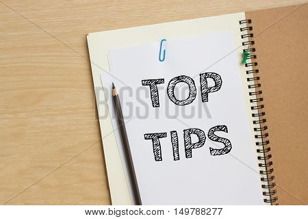 Text TOP TIPS on paper - business concept