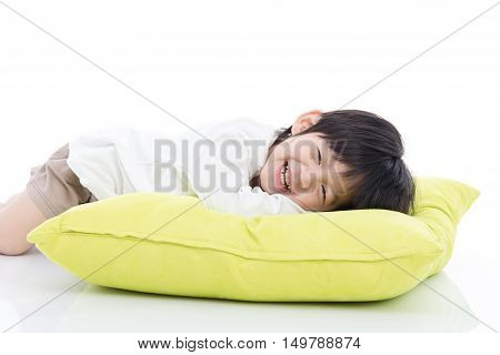 Cute Asian child lying on big pillowwhite background isolated