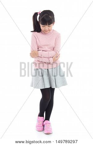 Beautiful Asian girl has a stomach ache on white background isolated