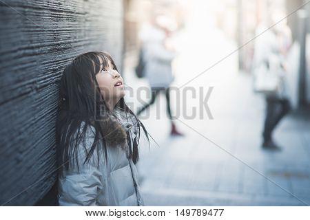 Beautiful asian girl looking up on streetGion Kyoto Japan