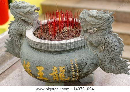 a burning Incense sticks in joss-stick pot in a chinese buddhism temple in Penang Malaysia