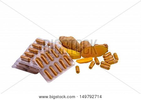 Turmeric herbal capsules and fresh turmeric root isolated on white backgroundoral medicine the alternative meditation