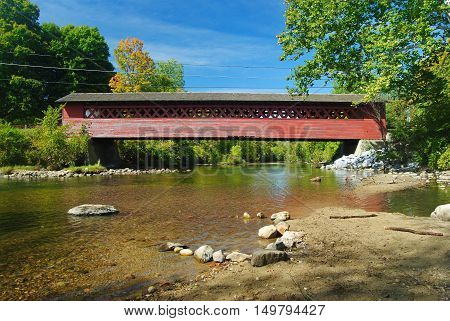 Burt Henry Covered Bridge spanning Wallomsac River in Bennington, Vermont.