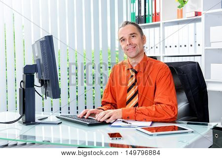 Young Business Man With Stamp At His Desk