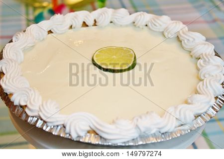 A whole key lime pie with whipped topping