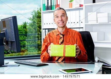 Business Man With Gift Box Looking Suprised