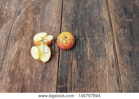 red apple and slice on wooden background top view with copy space.