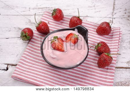 strawberry Yogurt on a white color wooden background