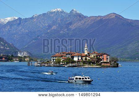 ISOLA PESCATORI-ITALY 25 APRIL 2013: fishing village Isola dei Pescatori on Lake Maggiore Italy; ISOLA PESCATORI-ITALY 25 APRIL 2013
