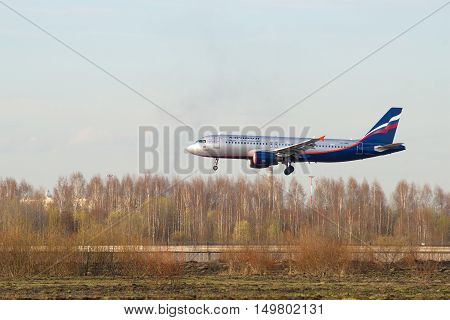 SAINT PETERSBURG, RUSSIA - APRIL 16, 2016: Plane Aeroflot Airbus A320-214 VP-BWD) is landing in Pulkovo airport.
