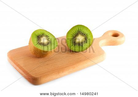 Halves Of Kiwi On The Cutting Board