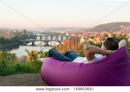 man is relaxing in an inflatable sofa