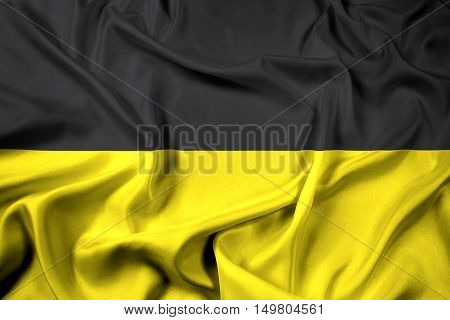 Waving Flag of Baden-Wurttemberg Germany, with beautiful satin background. 3D illustration