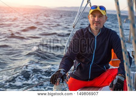 Portrait of a man the skipper on his yacht.