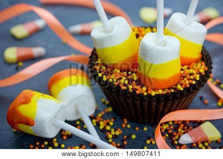 Halloween or Thanksgiving recipe candy corn marshmallow pops marshmallow on a stick dipped in chocolate