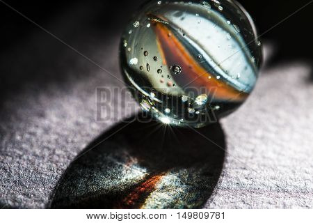 glass marbles studio macro closeup black background